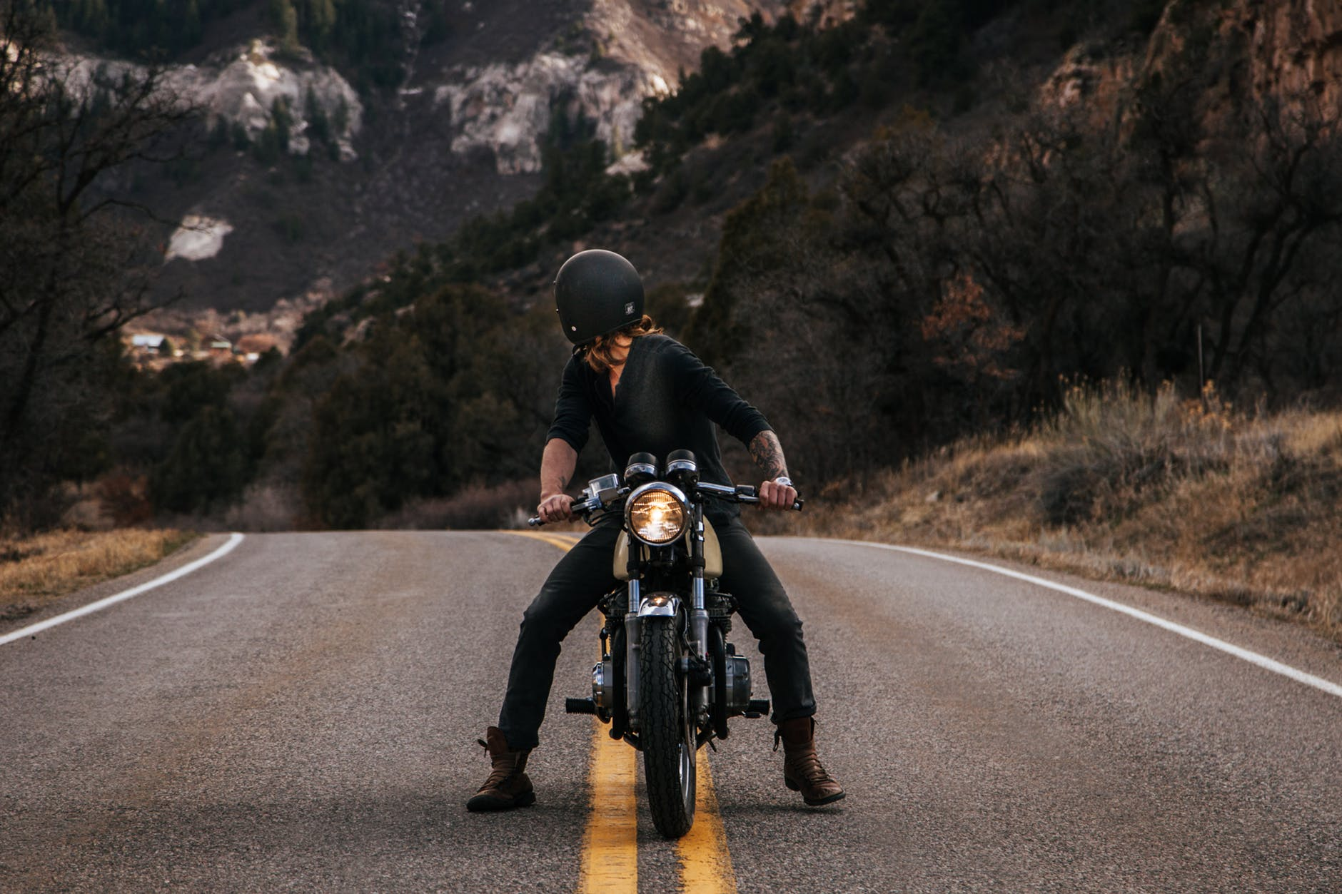 man riding boxer motorcycle on road